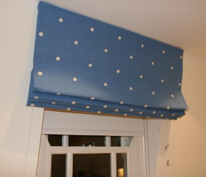 This embroidered cotton roman blind has been adapted for sloping ceilings