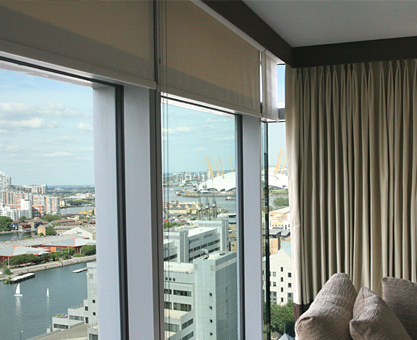 Made to measure curtains and roller blinds with pelmet in Canary Wharf Apartment