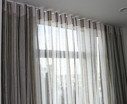 Striped linen curtains made to measure with wave heading and blackout curtains behind
