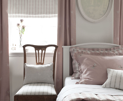 pink pastel curtains and quilted bedspread from Moghul