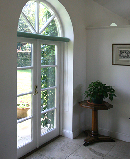 laminated roller blind in arched window